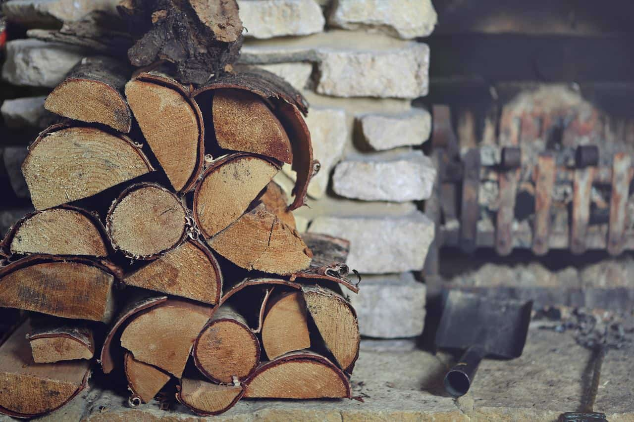stack of wood by fireplace